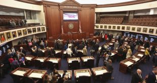 Visitors, Florida Senators and their staff members look at the new Florida Senate chamber in Tallahassee, Fla., Monday, Nov. 21, 2016. The chamber of the Florida Senate is reopening after a $6 million upgrade. (Scott Keeler/Tampa Bay Times via AP)