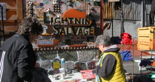 Customers went through racks of charred trinkets and knick-knacks, purchasing souvenirs to commemorate and remember Lightnin' Salvage Enterprises and support Satchel's Pizza's rebuilding efforts. (Antara Sinha/WUFT News)