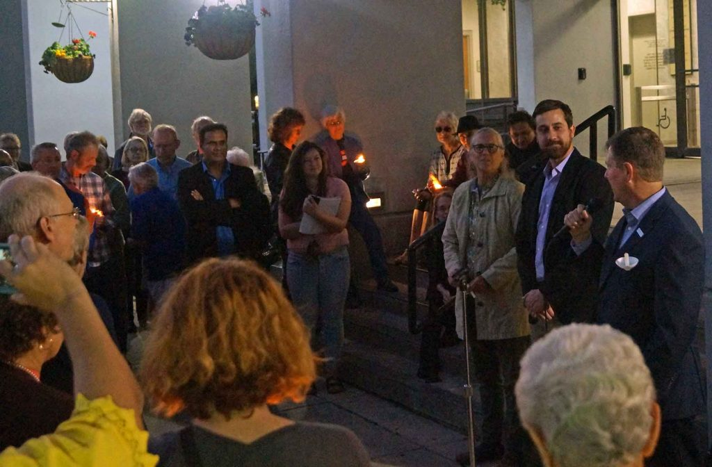 Mayor of Gainesville, Lauren Poe (far left), speaks in front of City Hall at the LIGHT In The Darkness event on Tuesday evening, December 6, 2016 (Jack DaSilva/WUFT News)