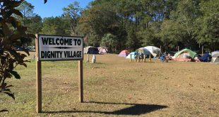 Dignity Village is a homeless camp next to GRACE Marketplace. Residents often live in tents and makeshift shelters, and go to GRACE for additional services and support. (Antara Sinha /WUFT News)