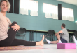 Yoga teacher Liz Getman (left) leads a class on Nov. 29 at GRACE Marketplace. The Gainesville homeless center has been offering the classes since August in an effort to bring the meditative exercise to the disenfranchised, Getman said. (Alexa Lorenzo/WUFT News)