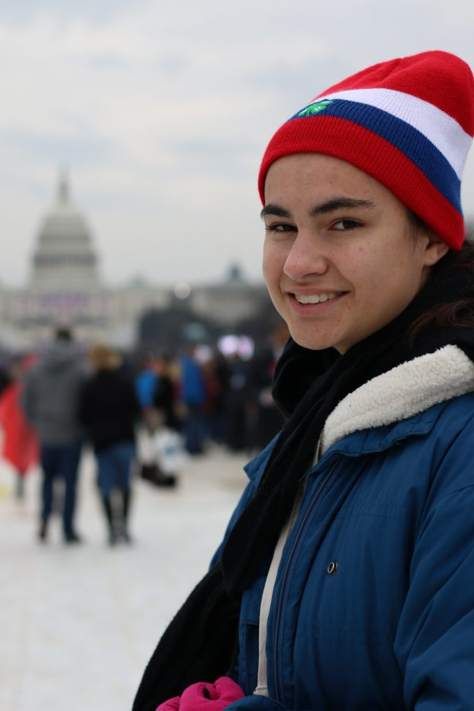 4-H member Miranda Bird poses for a photo at the capital on a cold day. (Photo courtesy of Shaumond Scott)