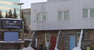 This photo taken Monday, Jan. 9, 2017, shows the Qupqugiaq Inn, a hostel-like motel in Anchorage, Alaska, where Florida airport shooting suspect Esteban Santiago stayed in a $35-a-night room before flying to Florida. Santiago is accused of killing five people and wounding six others Jan. 6, 2017, at the airport in Ft. Lauderdale, Florida. (AP Photo/Mark Thiessen)