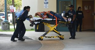 A shooting victim is taken into Broward Health Trauma Center in Fort Lauderdale, Fla., Friday, Jan. 6, 2017.  Authorities said multiple people have died after a lone suspect opened fire at the Ft. Lauderdale, Florida, international airport.  (Taimy Alvarez /South Florida Sun-Sentinel via AP)