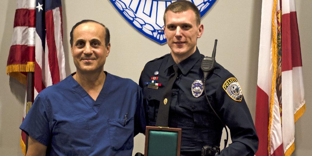 Officer Patrick Hopkins accepts Carnegie Medal