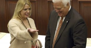 Florida attorney general and elector Pam Bondi, left, and secretary of state Ken Detzner confer before electoral members cast their presidential ballots at the state Capitol, Monday, Dec. 19, 2016, in Tallahassee, Fla. (AP Photo/Steve Cannon)