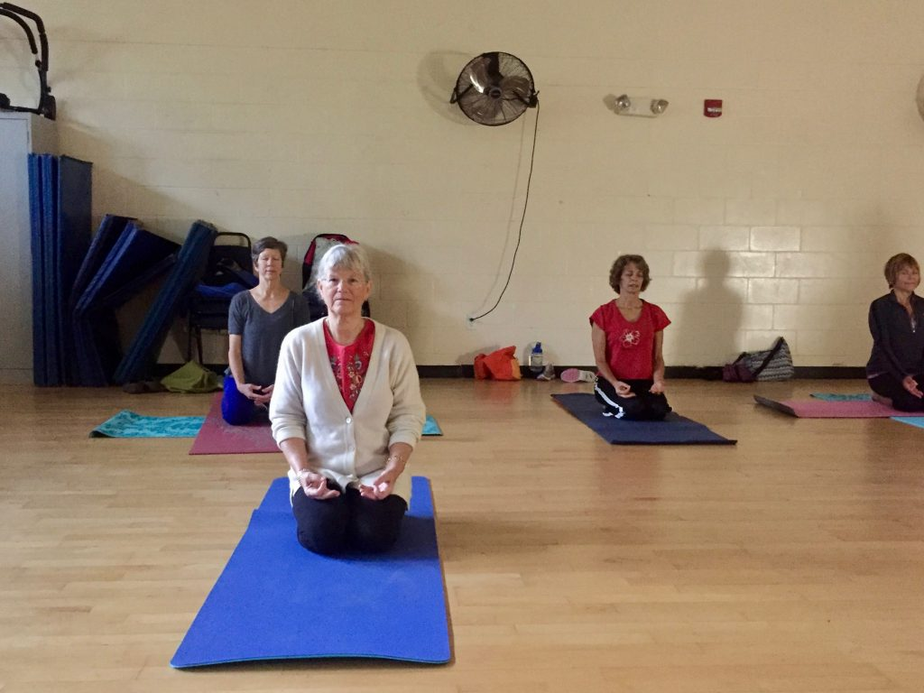 Jean Quillen, a YMCA member for four years, takes a yoga class. She said she never thought she would find such a strong community at a gym. (Monica Humphries/WUFT News)