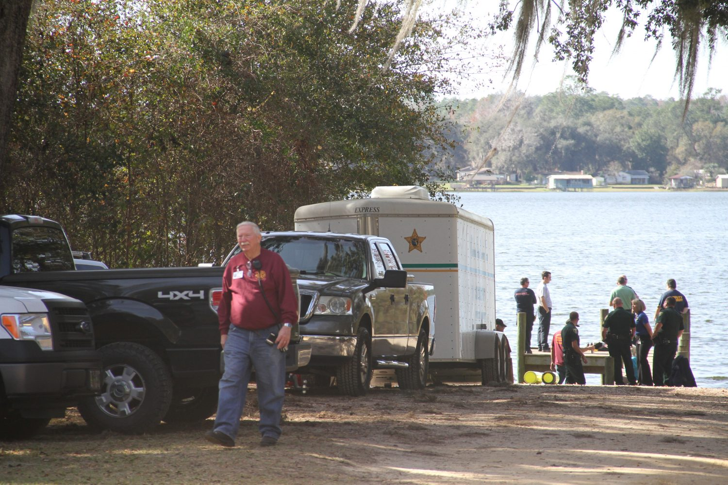Authorities assemble on the lake's public boat ramp this afternoon. (Eric Heubusch/WUFT News)
