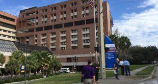 UF Health Shands employees walk outside hospital.