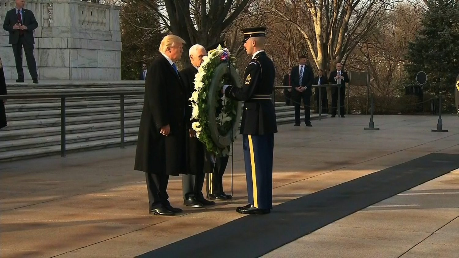 Donald Trump placed the wreath at Arlington National Cemetery in one of the kick-off ceremonial events in advance of his inauguration at the Capitol on Friday. Flanked by Mike Pence and standing before his children and families, Trump laid the wreath at the Tomb of the Unknowns in Arlington, Virginia.