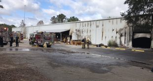 Fire rescue responds to a fire at Smiley's Antique Mall in Micanopy on Monday morning. (Troy Porter/WUFT News)