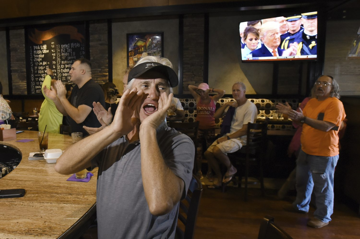 """Pete Molinaro from St. Augustine, Florida chants """"USA, USA"""" as other's at the Inauguration Watch Party applaud after President Donald Trump finished his inauguration speech at Whiskey Jax in Marsh Landing, Florida Friday, Jan. 20. 2017. (Bob Self/The Florida Times-Union via AP)"""