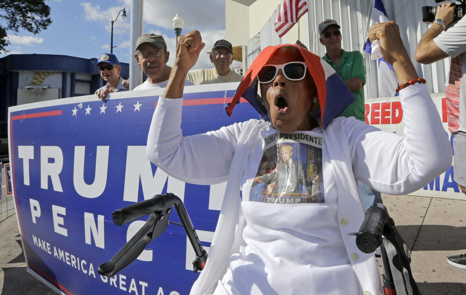 Cuban-American Ana Acosta Ayon chants pro Trump slogans, Friday, Jan. 20, 2017, in the Little Havana area in Miami, before President-elect Donald Trump is sworn in as the 45th president of the United States. (AP Photo/Alan Diaz)