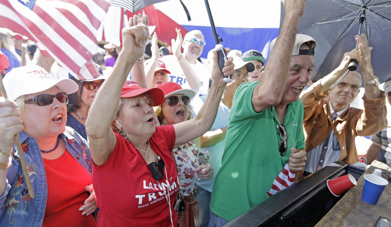 Cuban-American supporters celebrate in the Little Havana area in Miami, as they watch a televised broadcast as President-elect Donald Trump is sworn in as the 45th president of the United States, Friday, Jan. 20, 2017. (AP Photo/Alan Diaz)