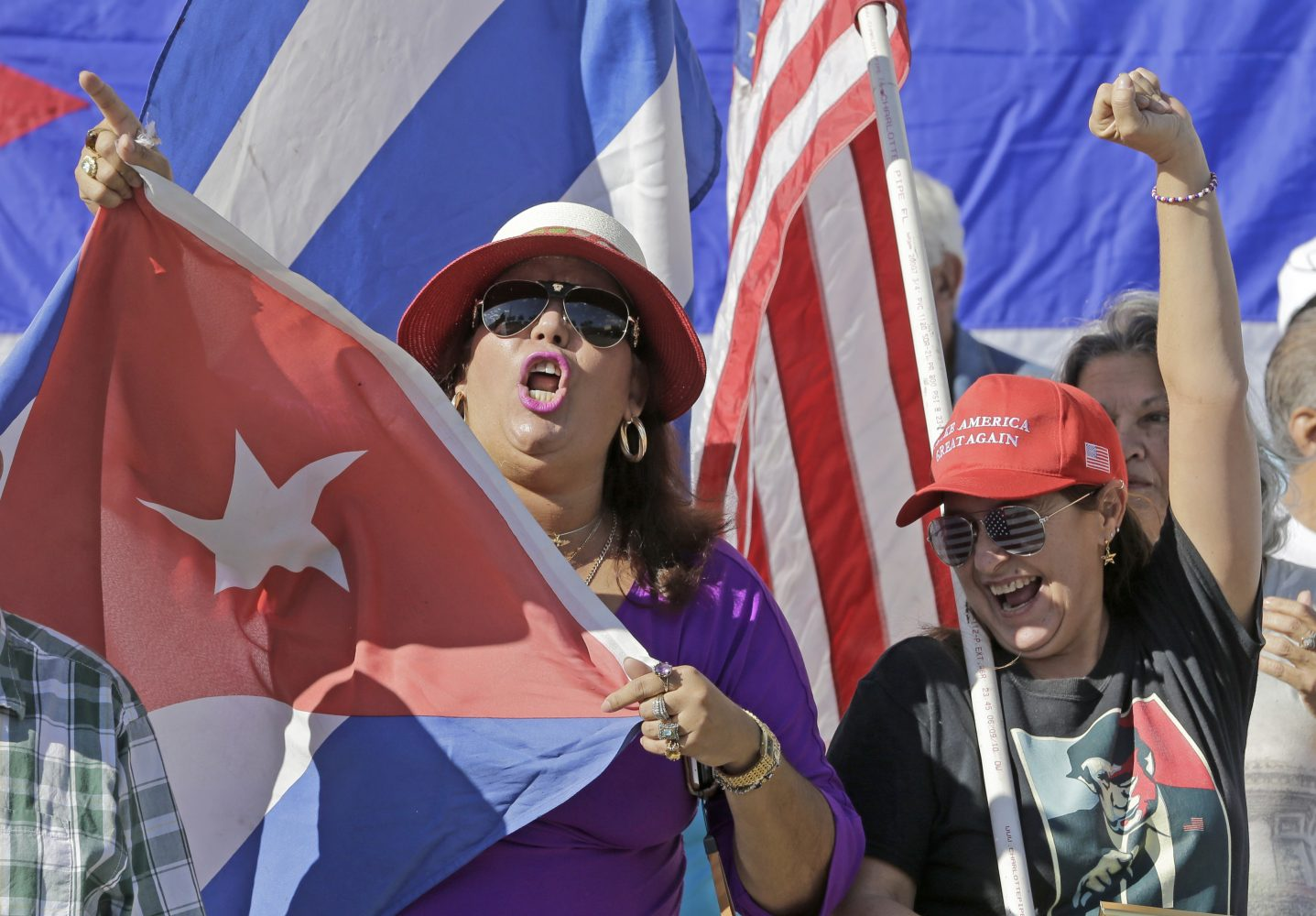 Cuban-Americans Dulce Martinez, left, and Alida Rivero chant pro-Trump slogans Friday, Jan. 20, 2017, in the Little Havana area in Miami, before President-elect Donald Trump is sworn in as the 45th president of the United States. (AP Photo/Alan Diaz)