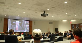 Members of UF's Multicultural and Diversity Affairs group watch Donald Trump's inauguration as the 45th President of the United States Friday. The group vows to hold Trump and other elected officials accountable for their actions and to keep citizens and students engaged in politics. (Brianna Wright/WUFT News)