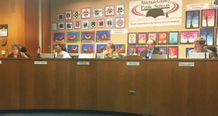 Alachua County School Board members discuss the proposed $3.25 million contract with Wisconsin-based Skyward Inc. to replace the school system's IT network at their Tuesday meeting. (Nealy Kehres/WUFT News)