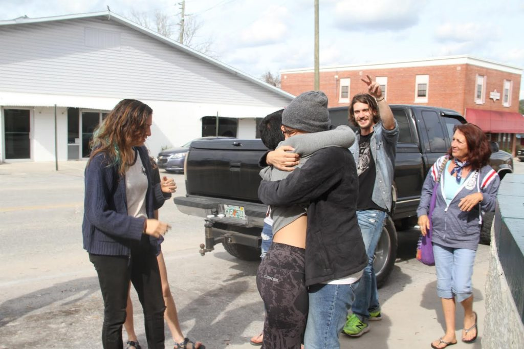 Kaithleen Hernandez and Alexa Oropesa hug as they both get released from the Suwannee County Jail Tuesday (Gaby Rodriguez/WUFT News)