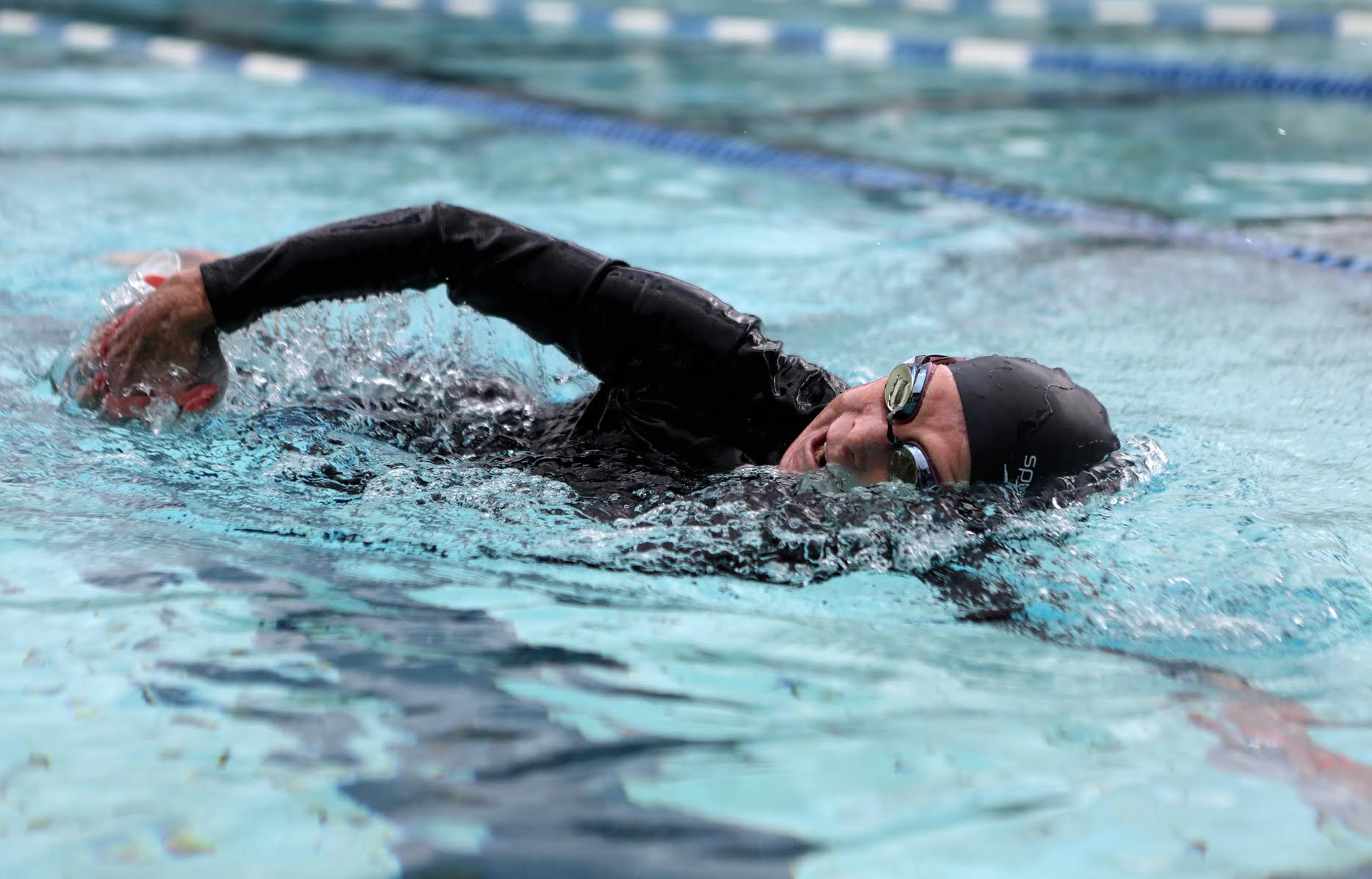Joan Fischer, 82, swims in the YMCA pool on Monday. The 20-year member said she would cry if the center closes.