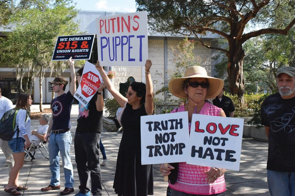 """9.Susan Shapiro (right) was one of dozens of guests to express opposition to Trump through peaceful protest. """"I'm standing up for those who did not vote for Trump,"""" she said. """"We are the majority"""" (Cindy Lu/WUFT News)"""