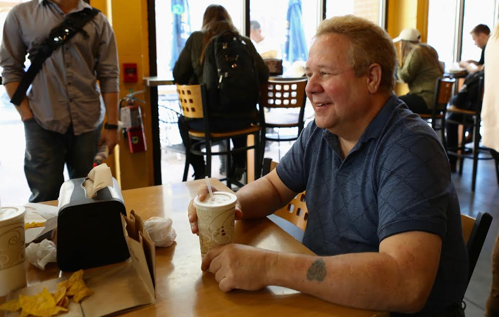 "Mike Wrenne, a 60-year- old IT expert for the UF College of Health and Human Performance, reminisces in Burrito Brothers on Monday about eating at the original location that fit customers ""like sardines."" (Emma Green/WUFT News)"