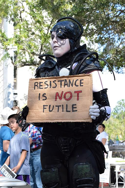 """10.Darsa Donelan took on a different approach to protesting. Dressed up as a Borg, an alien race from the Star Trek series, Donelan wanted to promote the idea that resistance is not futile, as the Borgs are known for saying. """"I want to resist the hatred that is in American right now,"""" she said. """"One of the important things from Star Trek for me is the equality of all people."""" (Cindy Lu/WUFT News)"""