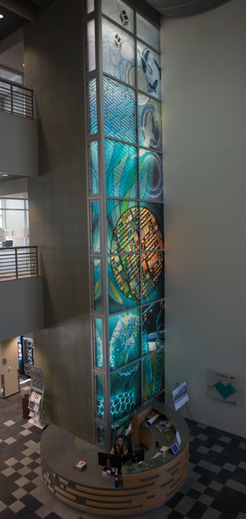 The backlit mural that is visible from every level of the Innovation Hub represents various research done at UF that has gone on to have real-world uses through corporations at the Innovation Hub. (Abby Stafford/WUFT News)