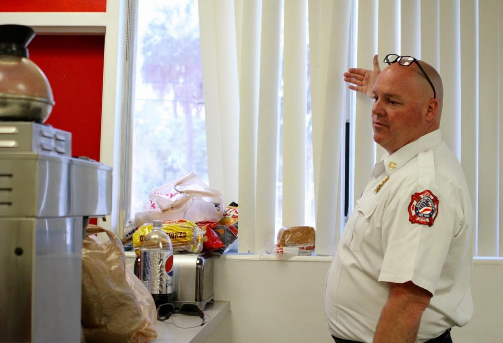 Newberry Fire Department Chief Ben Buckner stands in the fire station's kitchen while giving a tour of planned renovations slated to begin on Monday. The wall beside him will be knocked down to make room for more storage and living space. (Emma Green/ WUFT News)