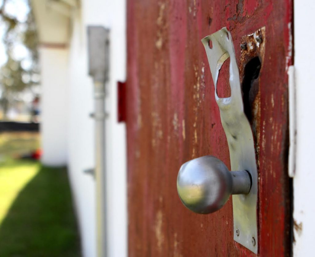 A rusted doorknob shows the Newberry Fire Department's age. A construction crew began working on renovations to the about 40-year-old station on Monday. (Emma Green/ WUFT News)
