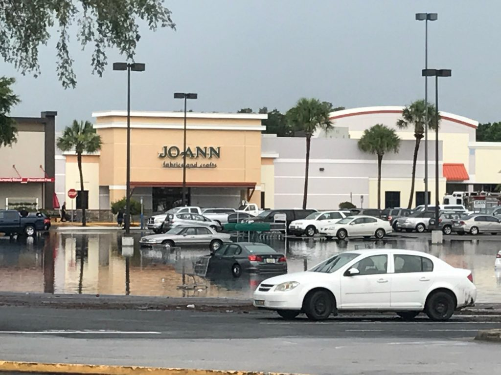 Sinkhole swallows car in Florida restaurant parking lot