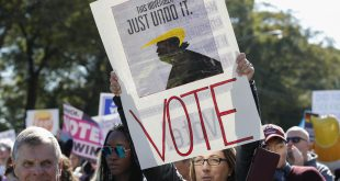 Women gather for a rally and march at Grant Park on Saturday in Chicago to urge voter turnout ahead of the midterm elections.