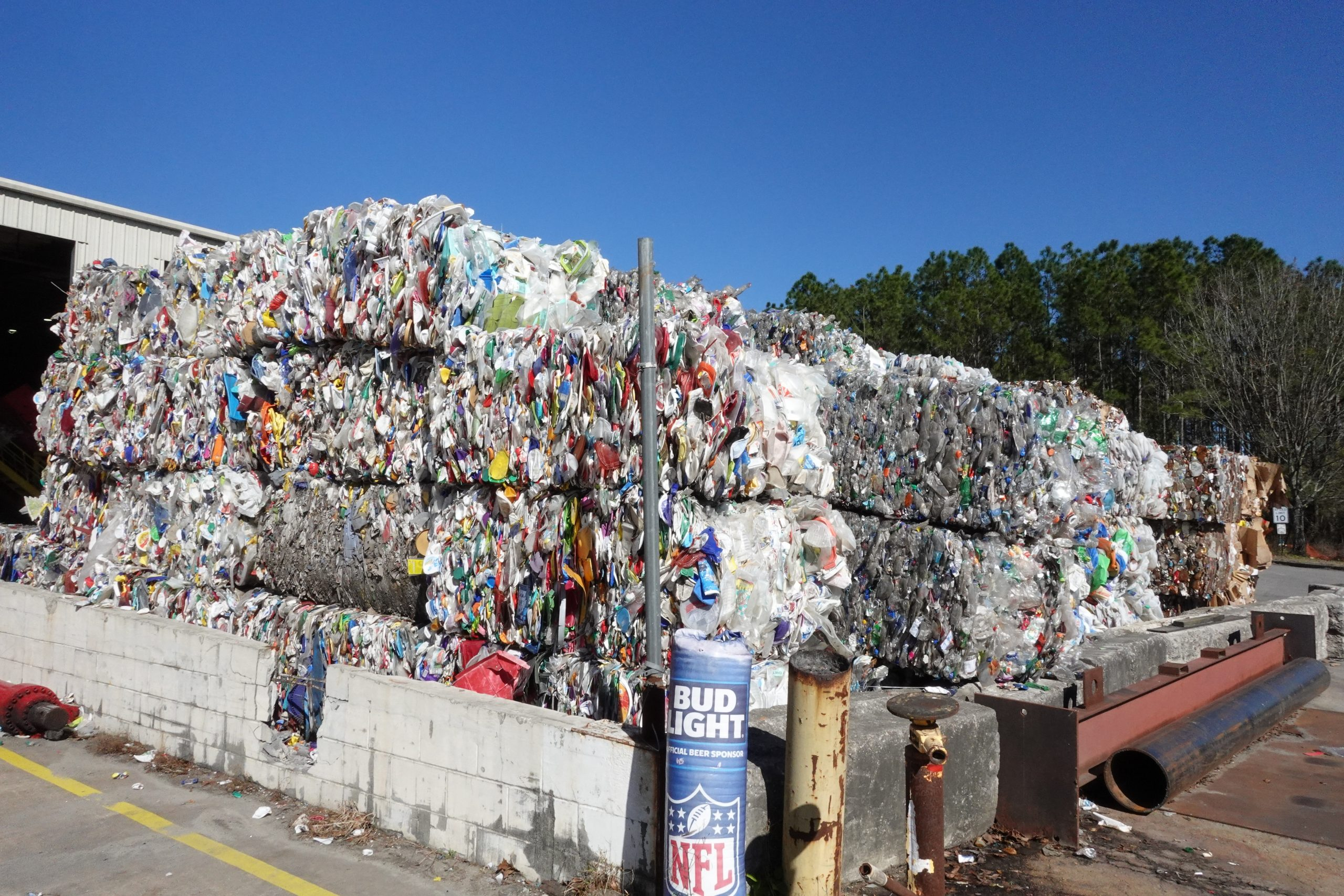 plastic materials are pushed and stacked into blocks