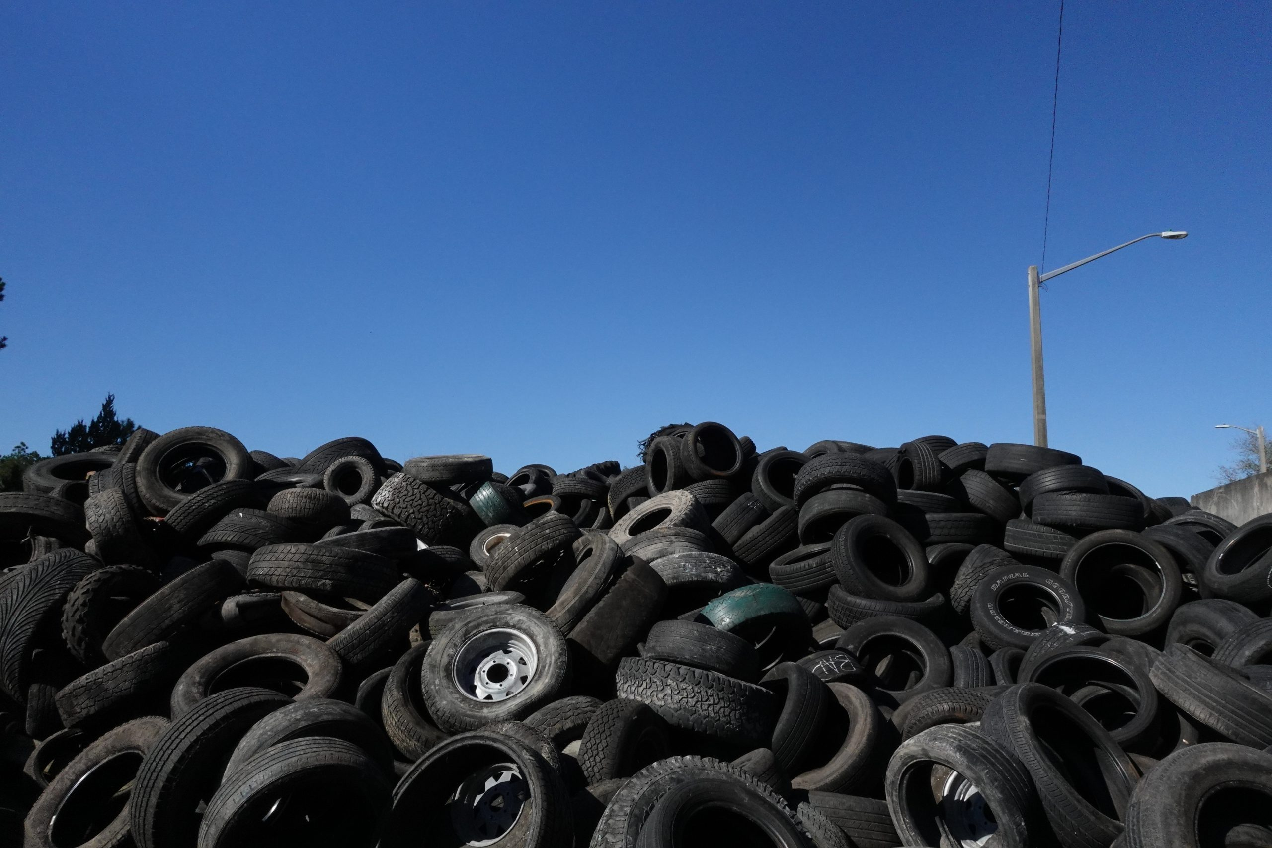 a pile of tires sits at the transfer station