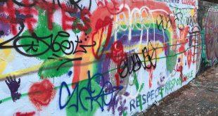 Graffiti covers the walls of 34th street.