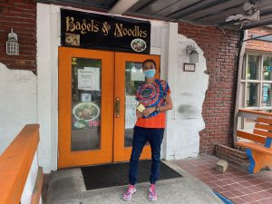 Toni Mills stands outside where she works, a restaraunt called Bagels and Noodles on University Ave. in Gainesville