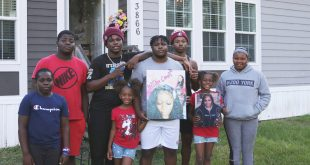 Natisha's eight children stand in the yard of their Newberry home.