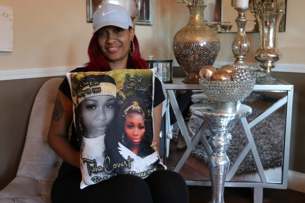 Tai Bey poses with a pillow with her friend, Natisha Covert, featured on it.