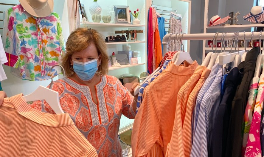 Agapanthus owner Paula King gets spring dresses ready to sell on May 28th, 2021.