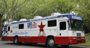 A bloodmobile is parked at the blood center. During the pandemic, bloodmobiles need to follow several limitations of parking places, including schools and businesses.