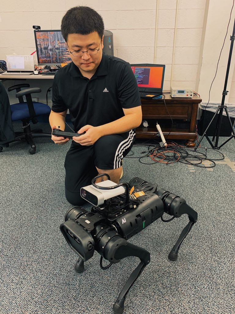 Fang Xu, a Ph.D. student from the group working with professor Du, operating a test version of the robotic dog.